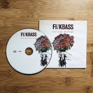 Finkbass' CD Cover and CD Kill Your Darlings lying on a wooden surface